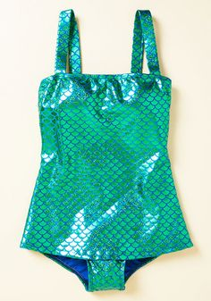 You'll feel one with the sea's exotic species when you dive through waves in this Esther Williams bathing suit! Designed with convertible straps, a smooth silhouette, a shelf bra, and low-cut legs, this royal blue beauty exhibits a full display of metallic green scales, this swimsuit elevates you to siren status.