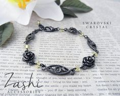 Pretty roses and coordinating details along with light yellow Swarovski crystals make this black bracelet romantic and elegant.