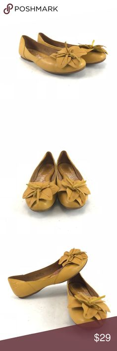 Yellow Born peony leather ballet flats Woman's pre-owned Born yellow peony leather ballet flats.  See pictures for condition.  Woman's size 7.5 Born Shoes Flats & Loafers