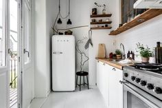 antique fridge & wood kitchen shelving | apartment interiors