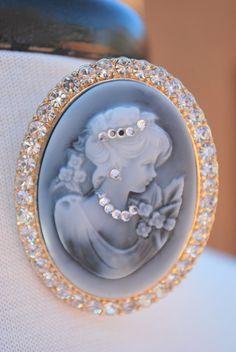 Vintage Big Blue Cameo Rhinestone Pink Brooch. $16.00, via Etsy.