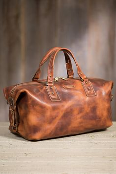 The spacious Americana accommodates your clothing and supplies with a vintage leather design that improves with age. Made in the USA.