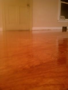 1/4 in plywood cut to 1 ft strips, nailed, and stained/polyurethaned for beautiful, inexpensive flooring.