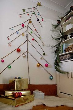 13 Creative ways to build a Christmas tree in small apartments. You can celebrate the holidays in style without taking up one more room in your place. I did #1 on the list last year and I am so happy I did. Saved money and it made a great conversation starter.
