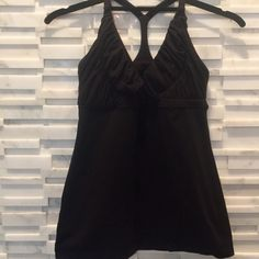 Lululemon black tank Adorable black lulu top. Excellent condition. The neckline line is plunging with rucked detail lululemon athletica Tops Tank Tops