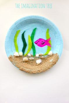Under the Sea Paper Plate Craft - The Imagination Tree - - Make a gorgeous under the sea paper plate craft using natural materials collected at the beach! This is such a fun kids craft idea for all ages to enjoy. Ocean Crafts, Vbs Crafts, Camping Crafts, Beach Crafts, Fun Crafts For Kids, Summer Crafts, Toddler Crafts, Preschool Crafts, Art For Kids