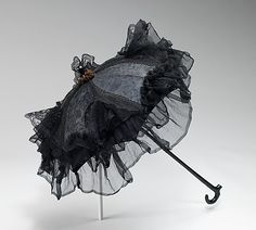 Parasols reached miniatrue sizes in the late 1850s and 1860s.  They were a frivolity which served no function but acted as an adornment around the bonneted head.  Parasol canopies echoed the skirt shape and tiered crinoline bands of the period, and like the flounces of the period, the fabric was woven à la disposition.