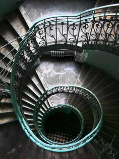 The famous Emerald Staircase in Warsaw, Poland, is an architectural delight. The emerald green banister creates a gorgeous green spiral. Love the emerald with the black and white harlequin patterned floor.