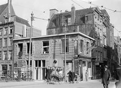 1940. View on the Jodenbreestraat. On the left the Zwanenburgwal. The Jodenbreestraat was home of Rembrandt, who lived in this street from 1639 to 1656 in a house that is still standing today. In the 17th century, many Jewish emigrants from Portugal and Spain settled in the neighbourhood, and in the 2nd half of the century, the southern section of the Sint Antoniesbreestraat came to be known as Jodenbreestraat. Photo ANP / Van Bilsen #amsterdam #1940 #jodenbreestraat