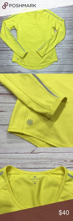 Athleta Women Running Wild Taped Crew Top Yellow Athleta Running Wild Taped Crew Top, Electric Yellow  In Great condition  #243316  Full wicking, breathable performance in a run top with Unstinkable technology, reflective tape and a back loop to hang your strobelight.  fabric + care  Polyester/Spandex  UNSTINKABLE. Wear it more. Wash it less.  Lasting odor control in the fabric  Wicks and breathes  Lightweight, soft, stretchy  Imported  Machine wash and dry.  fit + features  Fitted  Crew…
