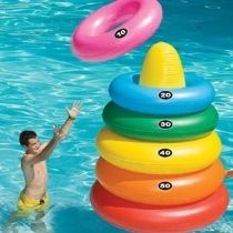 Giant Ring Toss multi-use product- for double the fun! Your favorite pool ring toss game magnified with a target buoy and 5 giant pool toss rings. When not playing, these rings are large enough to be used as pool tubes! Swimming Pool Games, Pool Rafts, Giant Inflatable, Inflatable Island, Ring Toss, My Pool, Pool Fun, Pool Accessories, Yard Games