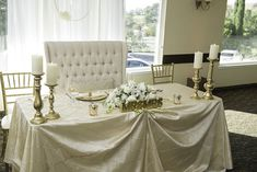 Gorgeous sweetheart table with vintage love seat and antique gold candelabras for the perfect romantic wedding setting. Wedgewood Weddings Indian Hills Wedding Venue located in the Inland Empire, of Riverside County.