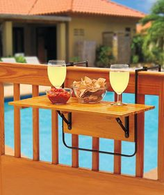 Folding Deck Table sets up in seconds and folds down flat when not in use. This attractive wood table comes with metal clamps and brackets that easily secure it to a porch or deck railing. Great for o
