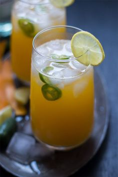 Tall Mango Jalapeno Fizzy Cocktail - A super fun and refreshing drink which combines the sweetness of mangoes with a spicy kick from jalapeños.