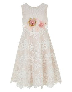 Our breath-taking Avery dress for girls is designed with a pleated bodice and full lace skirt, and is hand-embellished with beautiful flower corsages at the waist. This occasion-ready piece is lined for a comfortable fit, and finished with a satin bow on the back.