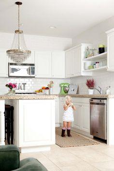 white kitchen, white subway tile with light floors
