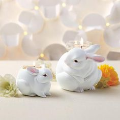 """Precious pairing of Mama Bunny and her little one. Set includes one tealight holder and one votive holder. Matte-finished, weather-resistant resin. 2½""""-3¾""""h, 3½""""w-4½""""w."""