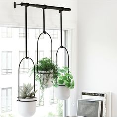 Perfect for your flat or apartment; get your hands on one of these Umbra Triflora Hanging Planters. Inspired by church bells and DIY hacks; this trio of durable melamine planters hang on a metal rod design, making it easy to water and display plants in yo Ceramic Wall Planters, Metal Hanging Planters, Corten Steel Planters, Hanging Pots, Ikea Hanging Planter, Modern Planters, Window Plants, Window Planter Boxes, Potted Plants