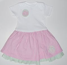 This is a tutorial for a skirted onesie but could be used on a t-shirt for a big girl.