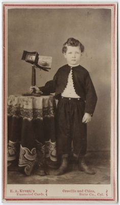 ca. 1855-95, [carte de visite portrait of a young boy with a steroscope], Edward Abraham Kusel