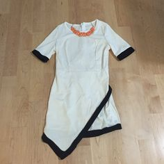 Last one  Flirty black and white dress White dress with black trimmings. Brand new. Tag says medium but fits like a small. Dresses