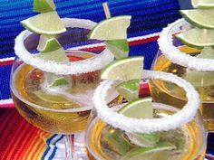 Beer Margaritas - We make ours like this:  1 can frozen concentrate limeade, 1 12-ounce beer, 2 cans of dt. 7-up (you can use regular 7-up I just try to reduce the calories a little bit and I can't tell the difference between the two), 1 limeade can filled with tequila and 3/4 limeade can filled with triple sec (I like to kick it up a notch!)   SUPER YUMMY!