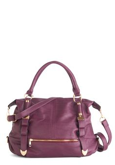 Every Day, Everywhere Bag in Plum. From day to night and every time in between, this rich purple bag is by your side. #purple #modcloth- While shopping with pals or dining with your honey, the gleaming gold accents and vegan faux leather of this spacious, sleek bag complement your look. Inspired by the bold paisley lining of this beloved purse, you slip on a mod shift dress and heeled boots to embark on another adventure together!