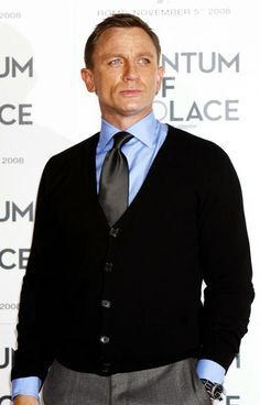 Daniel Craig sports a Rolex Submariner.  In fact, the same model that Sean Connery wears as James Bond in Goldfinger.