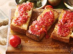 Fresh tomatoes, olive oil, garlic, salt, and bread are all you need for pan con tomate (spanish-style grilled bread with tomato).
