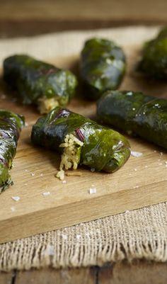 Dolmades (aka dolma, or waraq enab) recipe with beet leaves and rice. Great vegetarian recipe