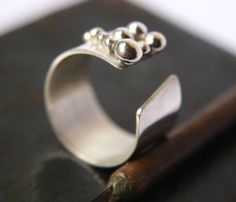 Wide Band Ring with Sterling Silver Beads Details by indiaylaluna Modern Jewelry, Metal Jewelry, Jewelry Art, Sterling Silver Jewelry, Jewelry Rings, Jewelery, Jewelry Accessories, Jewelry Design, Handcrafted Jewelry