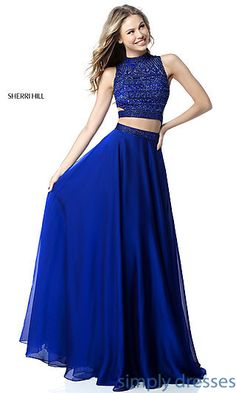 Shop long Sherri Hill two-piece prom dresses at Simply Dresses. Formal evening dresses with beaded high-neck crop tops and layered a-line skirts.