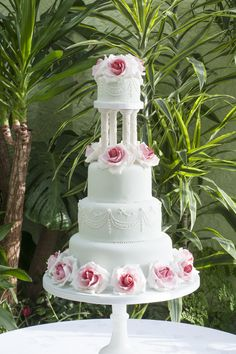 Four Tiered Wedding Cake Hand Piped Detail And Sugar Full Bloom Shaded Pink Roses With Plaster Pillars I Like The Between Top Tier One