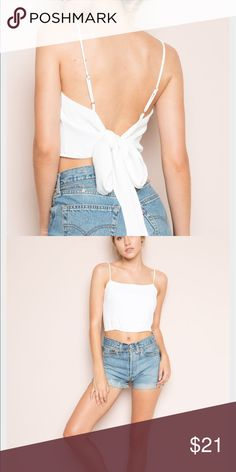 Nwt Brandy Melville Tie Back Top Never used. never worn. no trades. minor stain on front i found after purchasing. but lost receipt. tags attached Brandy Melville Tops Crop Tops