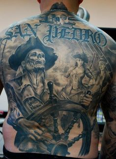 CARLOS TORRES...dammit he's awesome!!  Loving this Pirate tattoo: very unique & amazingly well executed.