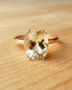OMG beautiful!  size, setting, warm glow!  amazing.  rose gold.  simplicity.   Double Prong Oval Sunstone Ring