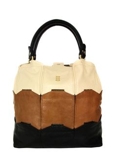 Orla Kiely – Willow, womens cream, tan and black leather patchwork tote bag. The bag features rolled leather handles, stud top fastening, golden Orla Kiely stem emblem and a protective studded base. Internally the bag is lined in brown and cream Orla kiely stem print lining with a single leather trimmed zip pocket, elasticated stripe keyring fob and two further patch pockets. £220 at Coggles.com
