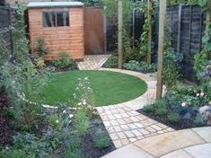 oval lawn as centrepiece of a small back garden design geometric lawns pinterest lawn and gardens