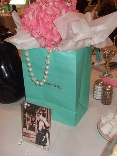 Custom Breakfast at Tiffany Inspired Bags Only - Centerpiece & Party Décor. Like the use of the bag and pearls as a centerpiece