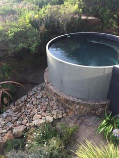 Concrete tank pool for the home for Concrete stock tank swimming pool