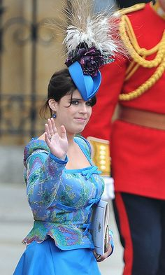 Princess Eugenie  It was all about the blue for Eugenie. Her smaller topper was embellished with feathers and a contrasting bloom.