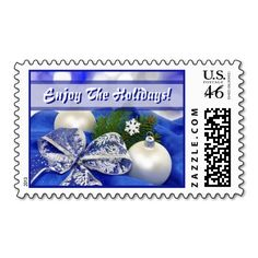 """Seasonal Ornaments Postage. Unique, trendy, chic and stylish Christmas holiday greetings mail stamps. With cute and fun image of white baubles and ornaments, white lace ribbon decorations and """"Enjoy The Holidays!"""" text. Original, elegant and classy stamps to personalize your December winter season wishes with."""