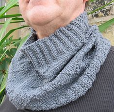 This cowl is designed to suit everyone. The textured pattern is understated but detailed enough to be interesting, and the deep moss ribbing ensures that cold winds are kept firmly away from the neck. It can easily be turned into a deeper cowl/snood by adding more vertical repeats of the pattern; it is written for knitting in the round. It was designed for someone who cannot tolerate wool next to the skin, and the yarn suggestions are both cotton blends that give excellent stitch definition.