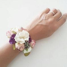 Weddbook is a content discovery engine mostly specialized on wedding concept. You can collect images, videos or articles you discovered organize them, add your own ideas to your collections and share with other people | This bracelet is designed and handmade with silk flowers by Lily Sarah. Delicate and pretty pieces for brides, bridesmaids and ladies. The wrist band is of unique design by me with wire and ribbons, is adjustable and fit for everyone. We are sure you will love them! As all…