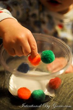 Pom-Pom Stuff It In – This is as easy as up-cycling a plastic container, making a couple of slits in the top, and grabbing some pom-poms. This is great for working on fine motor skills.