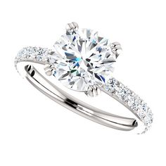 Our impressive flower moissanite bridal ring set, from Camellia Jewelry, will take her breath away. This charles and colvard ring set features a round cut forever one moissanite beautifully set in a solid white gold floral setting. Engagement Solitaire, Sapphire Diamond Engagement, Wedding Rings Solitaire, Princess Cut Engagement Rings, Bridal Rings, Wedding Engagement, Wedding Rings Simple, Wedding Rings Vintage, Vintage Engagement Rings