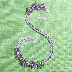 Decorative initial S from Stitch Sampler Alphabet, an ebook available on Needle 'n Thread.