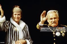 Prince Rainier III of Monaco waves from the balcony of the palace with wife Princess Grace Kelly celebrating principality's National Day on November 19, 1980 in Monte Carlo, Monaco.