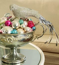 pretty  birds in a cluster of holiday ornaments