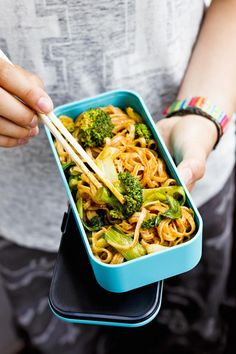 This meat-free lunch recipe for Potsticker Noodles from Vegan on the Go is delicious eaten hot or cold. An Asian medley of rice noodles and pak choi, coated in red curry paste and sesame oil. Fold in broccoli florets and fresh root ginger for a lunchbox that packs heat and a welcomed crunch. #veganuary #meatfree #vegan
